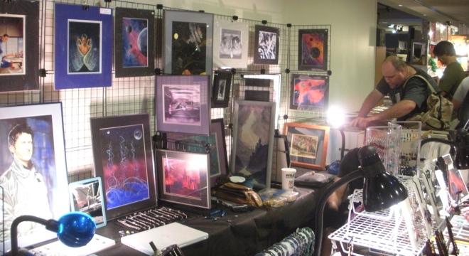 Art on display - and shoppers - in a vendor's hall. Photograph by the author, sockii.