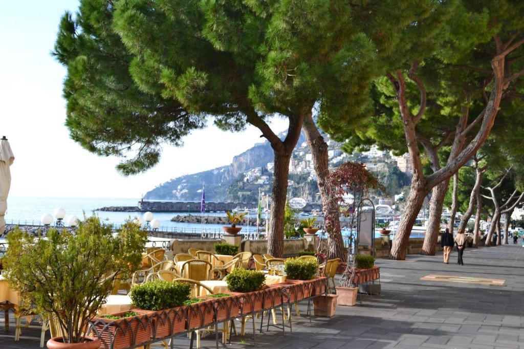 Grab a table with a view of the water, or walk along the promenade in Amalfi town.