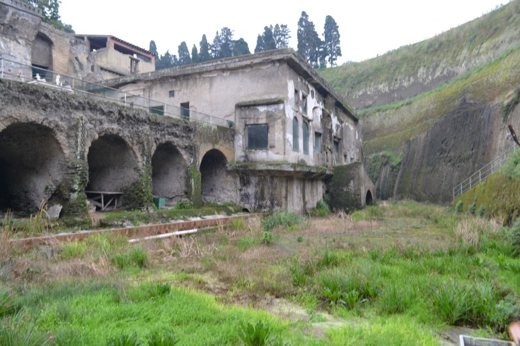 This is the original shoreline of Herculaneum. The archways to the left are where skeletal remains of 300 were found, hoping to escape death.