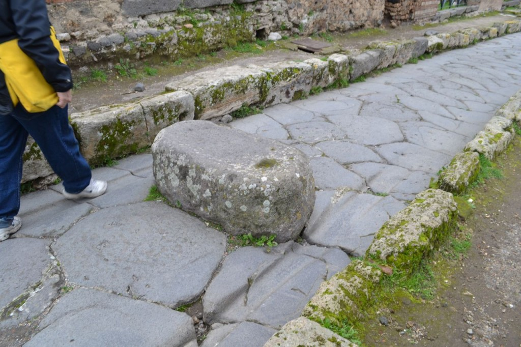 Here you can see a stepping stone on a one-way street - and also the grooves left by frequent chariot traffic!