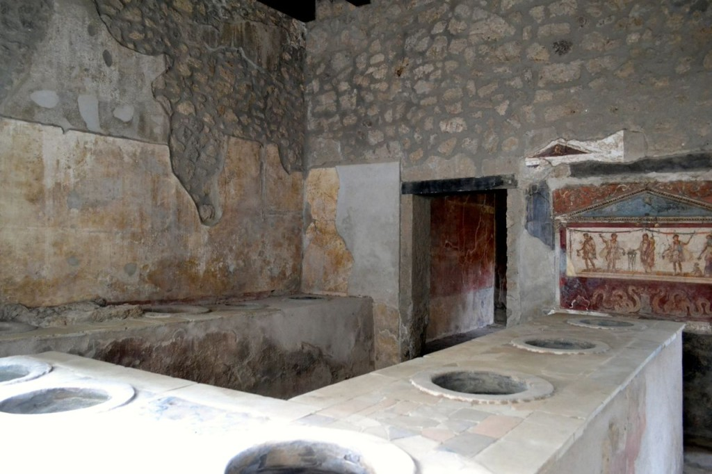 "The ruins of a Pompeii ""fast food"" restaurant or Thermopolium"