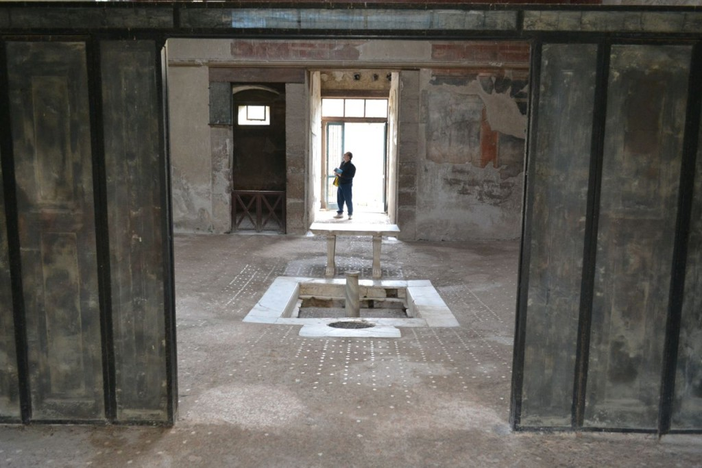 "The unique set of ""sliding doors"" found inside a Herculaneum villa."