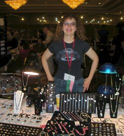 The author doing her job in a convention dealer's room.