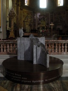 Modern art on display near the altar of the church.