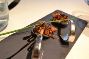 Octopus and Pine Nuts in Balsamic: a delightful amuse bouche served at Osteria Al Ponte del Diavolo.