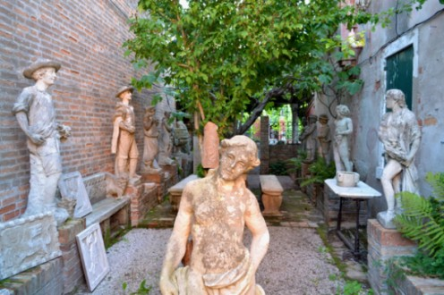 An alleyway on Torcello filled with sculpture and stone. An alleyway on Torcello filled with sculpture and stone.